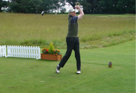 Photo of a man playing golf